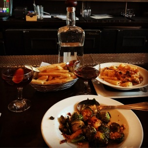 Enjoying a bit of the fare at Wood and Vine in Hollywood, California. Brussel Sprouts, House Cut Fries, Rigatoni and Whiskey Cheese and to drink: a NY City Capitol of France and a Black Manhattan. All delicious.