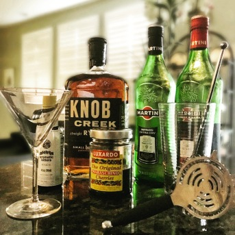 The Perfect Manhattan featuring Knob Creek Rye. Stir it with a half part each of sweet and dry vermouth and two dashes of angostura bitters over cracked ice and serve it up with a Luxardo cherry. It's... What's the word we're searching for?... oh yes, it's PERFECT.