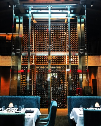 All hail the Wine Tower at Eddie V's, in San Diego, California! Fantastic seafood and steaks, artful cocktails and a deep wine list contained in a glass enclosed wine tower right in the middle of it all, accompanied by live jazz every night of the week. This place is a can't miss if ever there was one. Go!