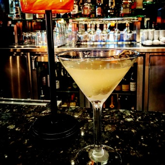 "The reason you can barely see the Vermouth-soaked, blue cheese-stuffed olives (trust us, they're there and they're spectacular) is that this is what we call a ""Filthy Martini."" Bottoms up!"